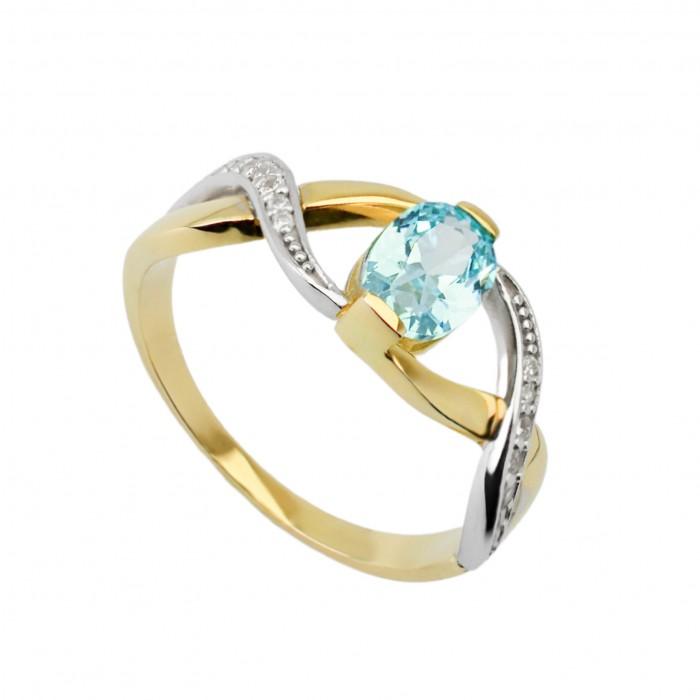 Pierścionek złoty z błękitną cyrkonią